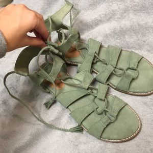 Laced up green sandals